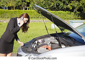 stress business woman calling for help with car broken...