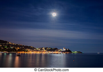 night view of Lerici village and mediterranean sea in...