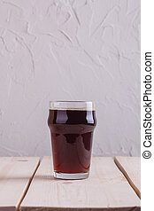 Pint of stout - Pint glass with dark stout beer on a light...