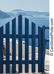 Santorini blue gate - Image of a blue gate looking out over...