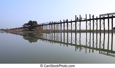 myanmar - People walk at U Bein Bridge longest teakwood...