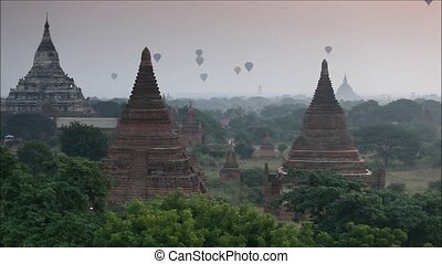 myanmar - Hot air balloon over plain of Bagan at sunrise,...