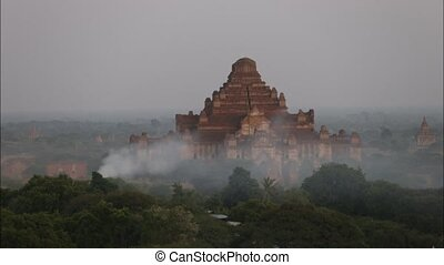 myanmar - Old pagoda of Bagan with smoke in evening , Bagan...