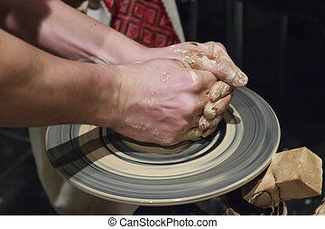 Hands of a potter at work