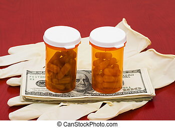 Medical Costs - A bottle of medication with cash on a wooden...