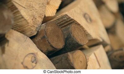 A background. A laying of chopped firewood. - A slow motion...