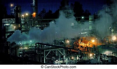 Smoking Industrial Facility At Nigh - Large industrial plant...