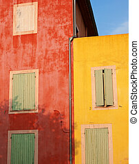 Colorful walls in Roussillon - colorful walls in the warm...