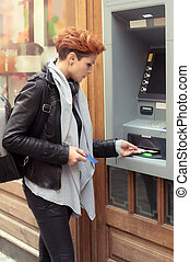 Business woman taking money from ATM - Business woman...