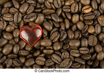 Coffee beans and red heart - Many coffee beans with red...