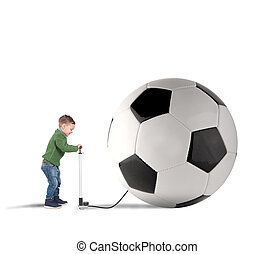 Big soccerball - Baby boy amused swollen a big soccer ball
