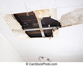 Water damaged ceiling .