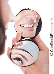 reflection of woman smile in mirror