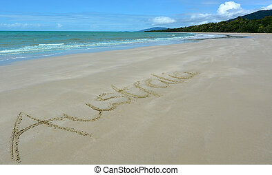 The word Australia written in sand on the seashore of Cape...