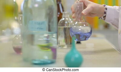A technician is checking the quality of water - A lab with...
