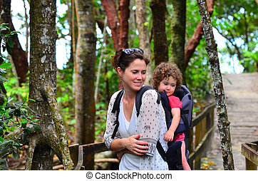 Hiking - Mother and child travels in the tropical north of...