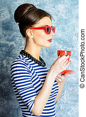 lady drinks a tea - Fashionable lady in elegant dress and...