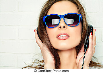 radio DJ - Modern young woman enjoys the music on...