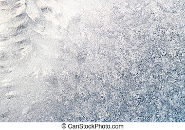 Frosted window with tracery - Close-up of ice crystals on a...