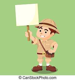 boy explorer holding sign