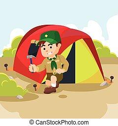 boy scout preparing tent