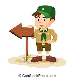 Boy scout holding arrow sign