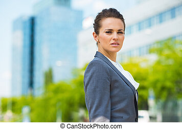 Portrait of confident business woman in modern office...