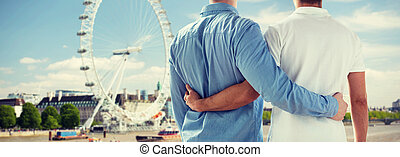 close up of male gay couple over london - homosexuality,...