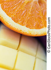 close up of fresh juicy orange and mango slices - healthy...