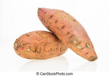 Fresh sweet potatoes , isolated on white background