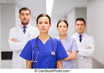 group of medics or doctors at hospital - clinic, profession,...