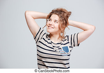 Smiling woman looking away isolated on a white background