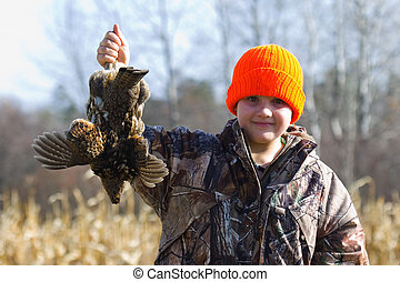 Grouse Hunter - A young hunter with a Ruffed Grouse