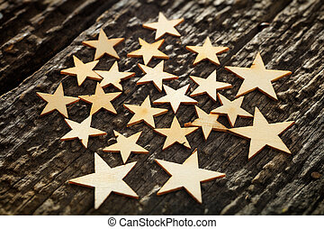 Wooden carved stars on tree bark - Close-up of wooden stars...
