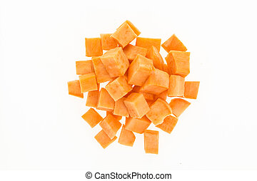 Fresh sweet potato cut into cubes , isolated on white...