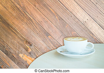 White cup of coffee latte on wooden backgound