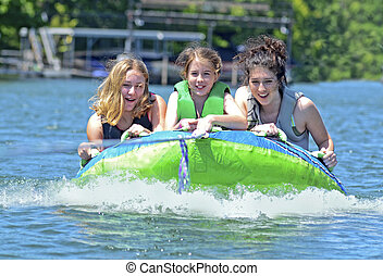 Three Girls on a Tube - Three girls having fun on a tube...