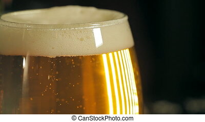 Beer bubbles in a glass - A glass of fresh light beer. There...