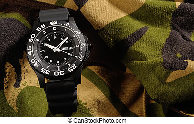 Tritium military watch on camouflage clothing