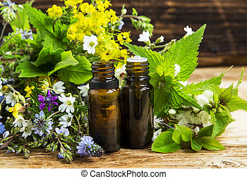 Herbal medicine with plants exracts and essence bottles -...