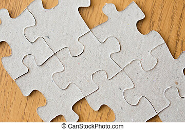close up of puzzle pieces on wooden surface - business and...