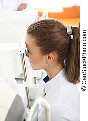 Computer aided visual acuity. - The patient during an eye...