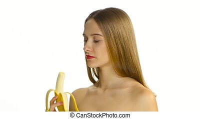 Girl with braces eating a big banana. White. Closeup -...