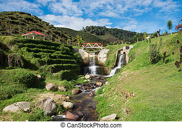 Artificial waterfall with blue sky in Cameron Highlands