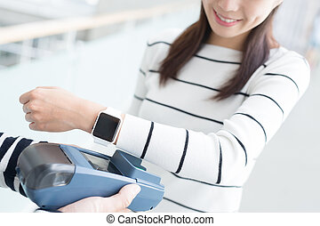 woman pay by smart watch - young woman pay by smart watch...