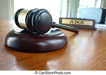 Judges gavel - Court gavel on a desk with Judge nameplate in...