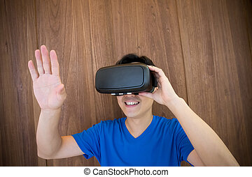 man using VR headset glasses - Smile happy man getting...