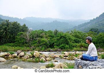 Thai women travel and playing at Taha Waterfalls at Ban...