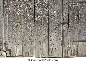 wood with staples and pins - old weathered wooden gate...