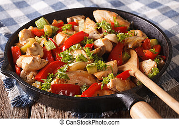Chicken saute with mushrooms, peppers and zucchini closeup...